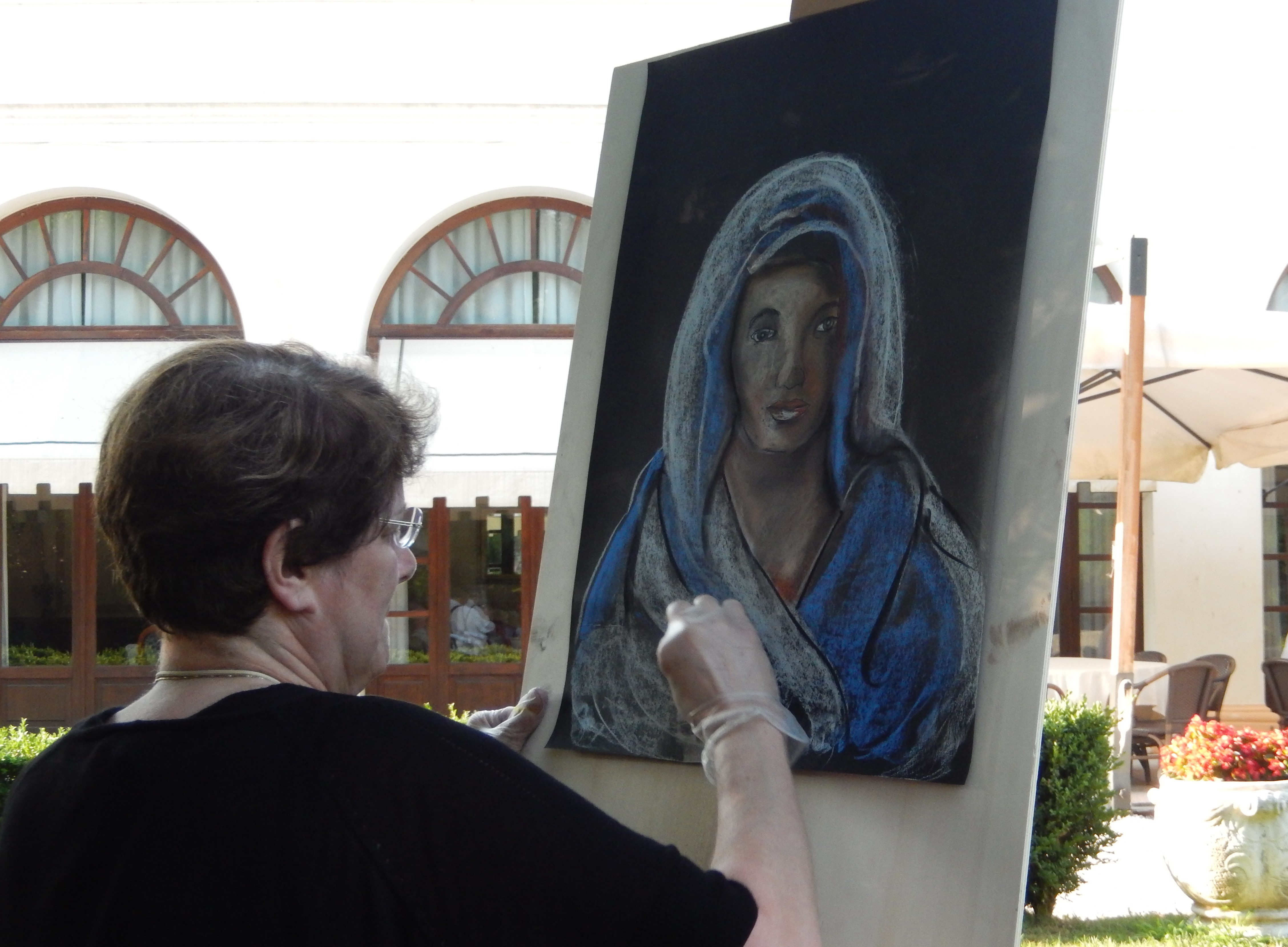 Mary Hilger doing a Live Drawing in Italy